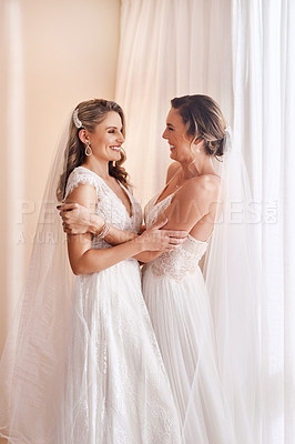 Buy stock photo Cropped shot of two attractive young brides holding each other in excitement before their wedding