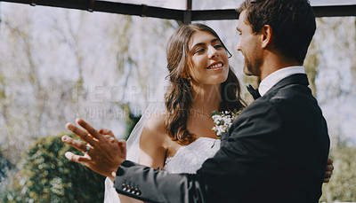 Buy stock photo Cropped shot of an affectionate young newlywed couple dancing together on their wedding day