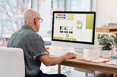 Buy stock photo Shot of a senior creative businessman working on a computer inside his office