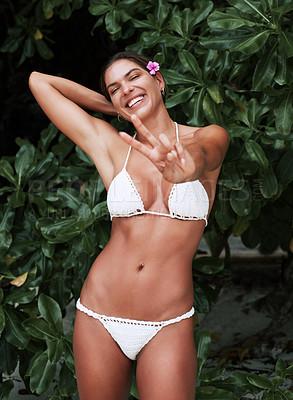 Buy stock photo Cropped shot of a beautiful young woman posing in her bikini