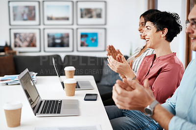 Buy stock photo Cropped shot of a diverse group of businesspeople sitting together and clapping after a successful meeting in the office
