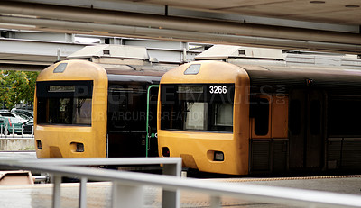 Buy stock photo Cropped shot of two yellow trains parked in an empty train station during the day in Portugal