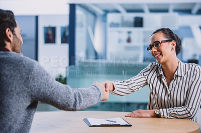 Buy stock photo Cropped shot of an attractive young businesswoman shaking hands with a male colleague after a successful interview in the office