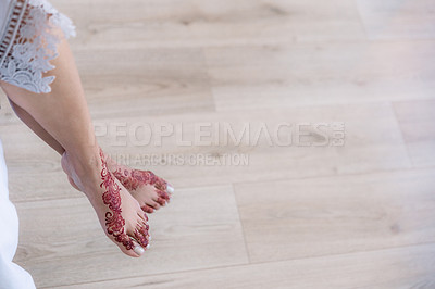 Buy stock photo Cropped shot of an unrecognizable woman with mehendi painted on her feet on her wedding day