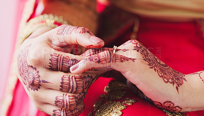 Buy stock photo Cropped shot of an unrecognizable woman holding a ring in preparation for her wedding