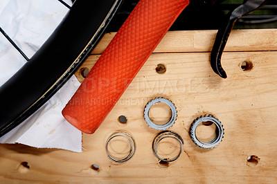 Buy stock photo Closeup shot of bicycle parts in a repair shop