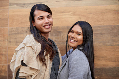 Buy stock photo Cropped portrait of two affectionate young friends smiling while standing together outdoors