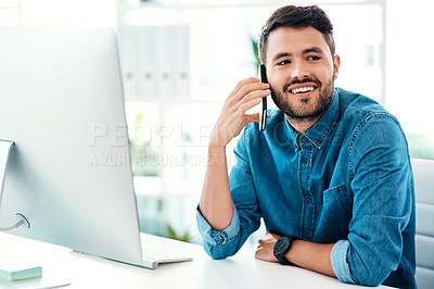 Buy stock photo Cropped shot of a handsome young businessman looking contemplative while taking a phonecall in an office