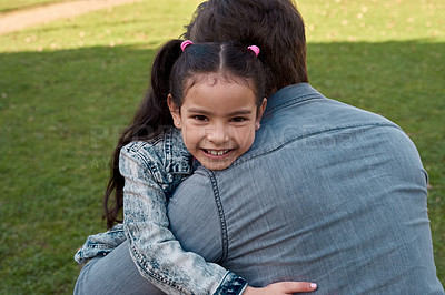 Buy stock photo Shot of an adorable little girl embracing her father at the park