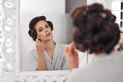 Buy stock photo Shot of a woman applying makeup for a special occasion
