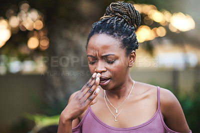 Buy stock photo Shot of a young woman suffering from allergies