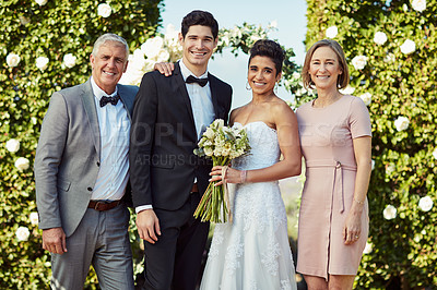 Buy stock photo Portrait of a happy young couple standing with their parents on their wedding day