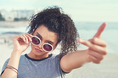 Buy stock photo Cropped shot of a young woman showing middle finger