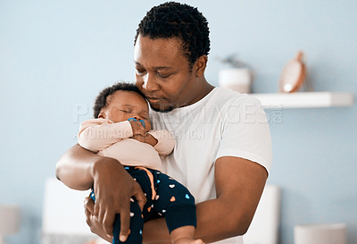 Buy stock photo Shot of a father bonding with his adorable infant daughter at home