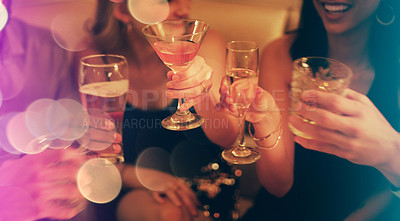 Buy stock photo Cropped shot of a group of young friends toasting with their drinks in a nightclub