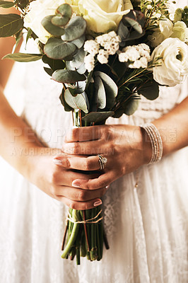 Buy stock photo Cropped shot of an unrecognizable bride holding a bouquet of flowers on her wedding day
