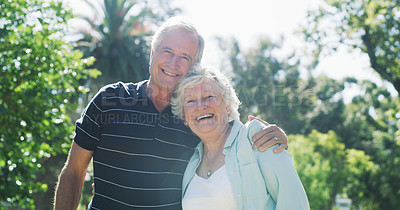 Buy stock photo Cropped portrait of an affectionate senior couple standing together in a park during the day