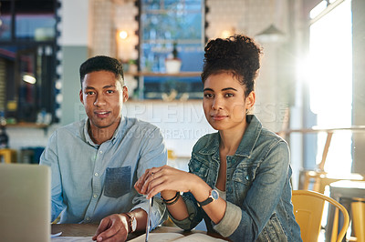 Buy stock photo Cropped shot of two young cafe owners sitting together in a coffee shop before having a meeting
