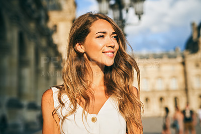 Buy stock photo Shot of a beautiful young woman exploring the city of Paris