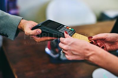 Buy stock photo Cropped shot of an unrecognizable woman making a payment using a credit card at a hotel front desk