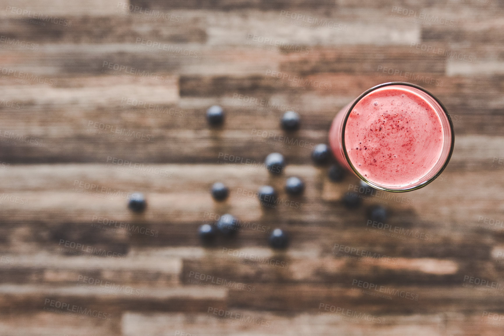 Buy stock photo High angle shot of a smoothie on a table