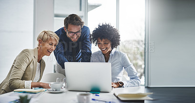 Buy stock photo Cropped shot of a diverse group of businesspeople using a laptop during a meeting in the office