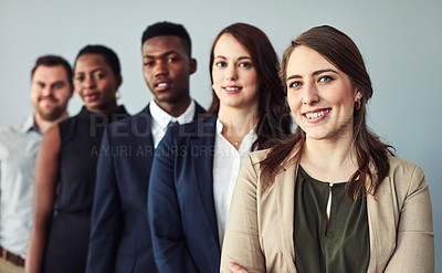 Buy stock photo Studio portrait of a group of businesspeople standing in a row against a grey background