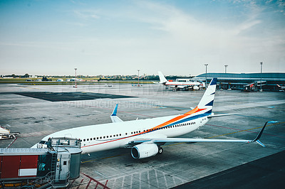Buy stock photo Cropped shot of aircrafts parked in their stands at an international airport during the day