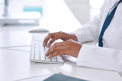 Buy stock photo Cropped shot of an unrecognizable young female scientist working on her computer in the laboratory