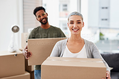 Buy stock photo Shot of a young woman moving into a new house with her boyfriend in the background