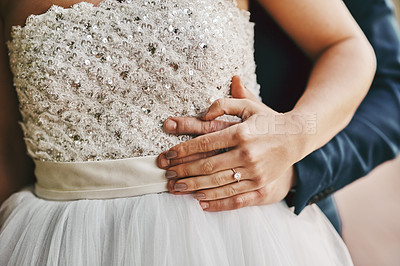 Buy stock photo Cropped shot of a unrecognizable couple standing together on their wedding day