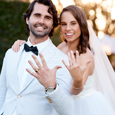 Buy stock photo Cropped shot of a newlywed couple showing off their wedding rings