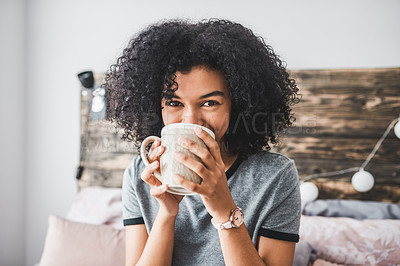 Buy stock photo Cropped shot of a young woman enjoying a hot beverage while sitting in her room