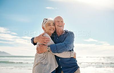 Buy stock photo Shot of a senior couple having a fun day at the beach