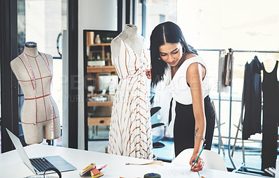 Buy stock photo Shot of a successful young fashion designer working on her latest design