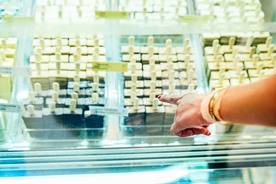 Buy stock photo Cropped shot of a woman choosing an ice cream a store