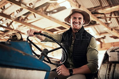 Buy stock photo Portrait of a handsome young farmer posing while sitting inside a tractor at his farm