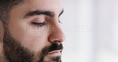 Buy stock photo Closeup shot of a young businessman looking thoughtful in an office