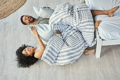 Buy stock photo Shot of a playful couple spending quality time together in their bedroom