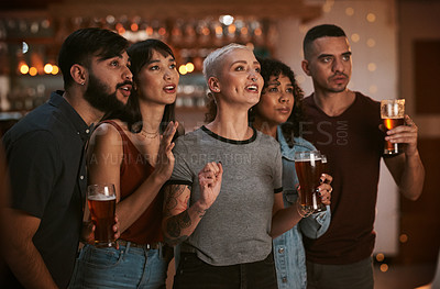 Buy stock photo Shot of a group of friends having drinks while watching the game at a bar