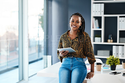Buy stock photo Cropped portrait of an attractive young businesswoman sitting alone in her office and using a tablet