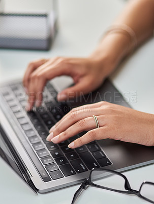 Buy stock photo High angle shot of an unrecognizable businesswoman working on a laptop in her office