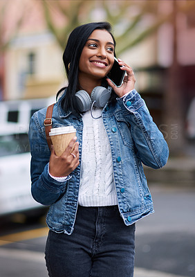 Buy stock photo Cropped shot of a beautiful young woman talking on her cellphone while out in the city