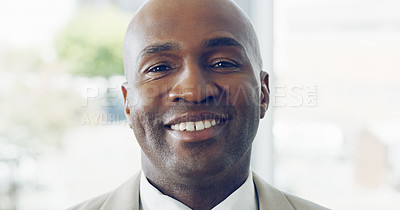 Buy stock photo Cropped portrait of a handsome young businessman smiling while standing in a modern office