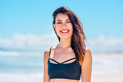 Buy stock photo Portrait of a sporty young woman at the beach