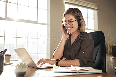 Buy stock photo Cropped shot of a call centre agent working at her desk