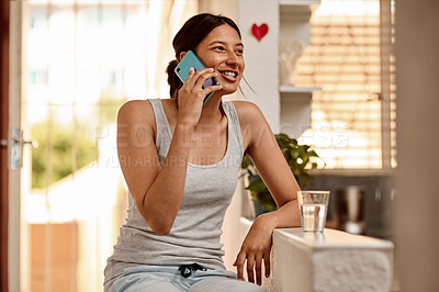 Buy stock photo Shot of a young woman using a smartphone in the morning at home