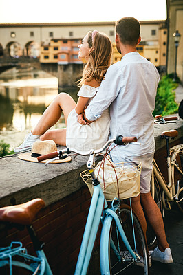 Buy stock photo Shot of an affectionate couple sight- seeing in a foreign city