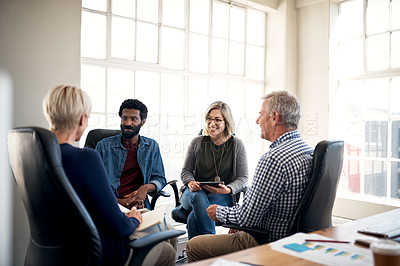 Buy stock photo Shot of a diverse group of creative businesspeople having a meeting together inside a modern office