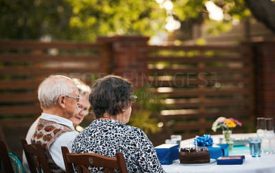 Buy stock photo Cropped shot of a group of senior people sitting together during a tea party outdoors